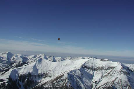 Hot air balloon rides allow for breathtaking aerial views of mountains.