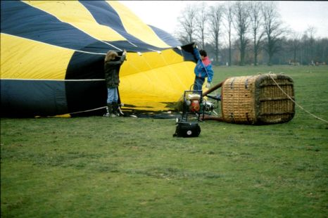 Using a fan to inflate the hot air balloon envelope.