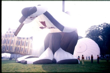 A hot air balloon shaped as a pirate ship is being inflated.